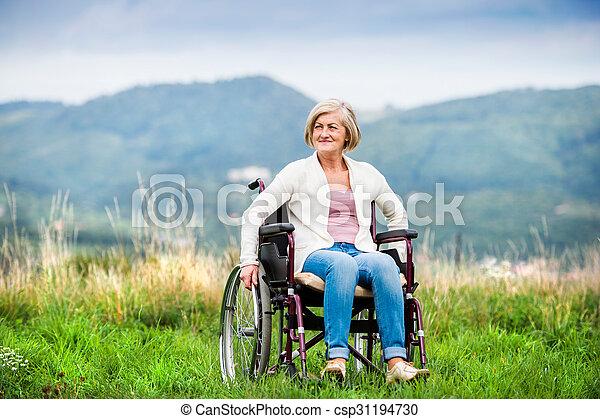 Woman in wheelchair - csp31194730