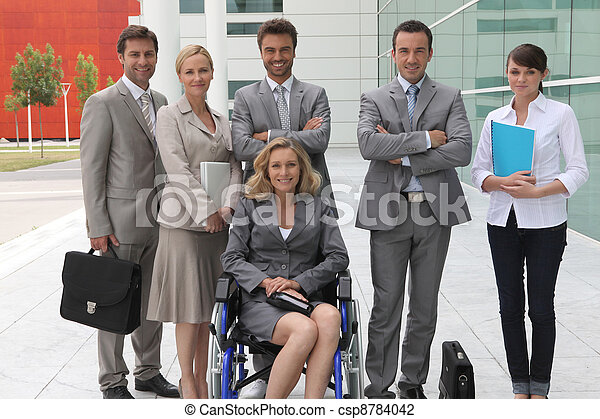 woman in wheelchair with colleagues - csp8784042