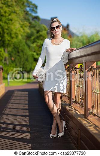 woman in white dress - csp23077730