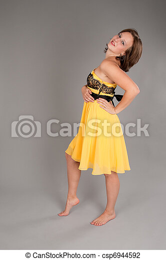 woman in yellow dress - csp6944592