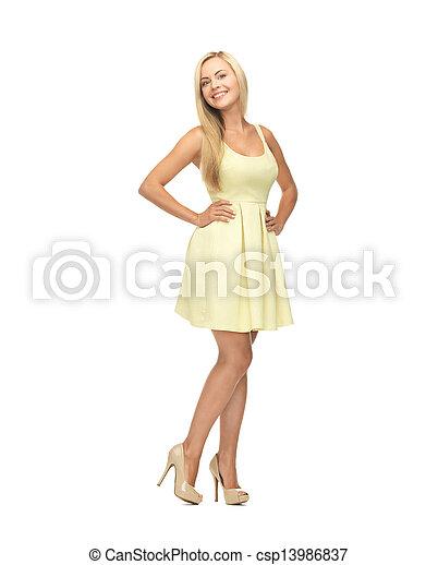 woman in yellow dress - csp13986837