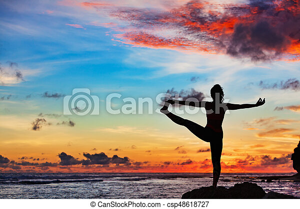 Woman In Yoga Pose On Sea Beach Rock
