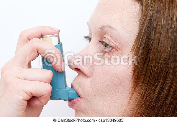 woman inhaling her asthma pump - csp13849605