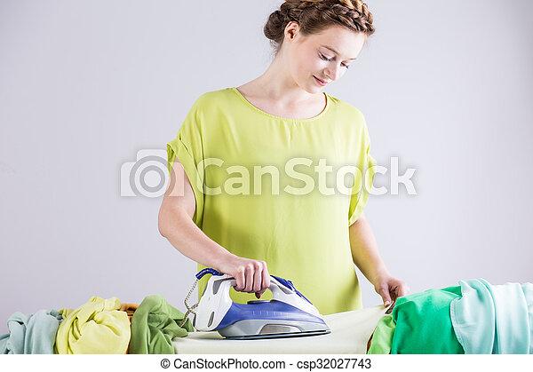 Woman ironing clothes - csp32027743