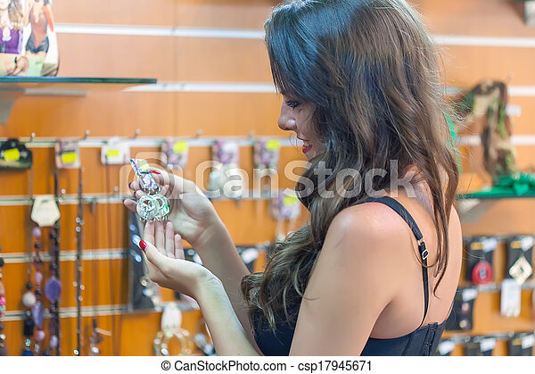 woman is choosing jewerly - csp17945671