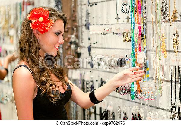 woman is choosing jewerly - csp9762976