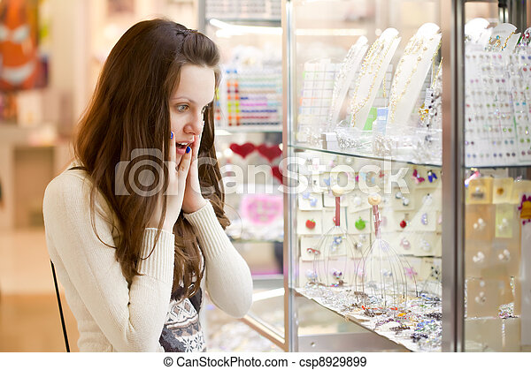woman is choosing jewerly - csp8929899