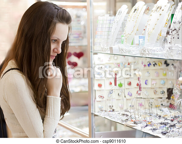 woman is choosing jewerly - csp9011610