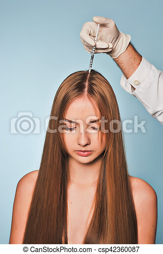 woman is getting injection in head. Mesotherapy. - csp42360087