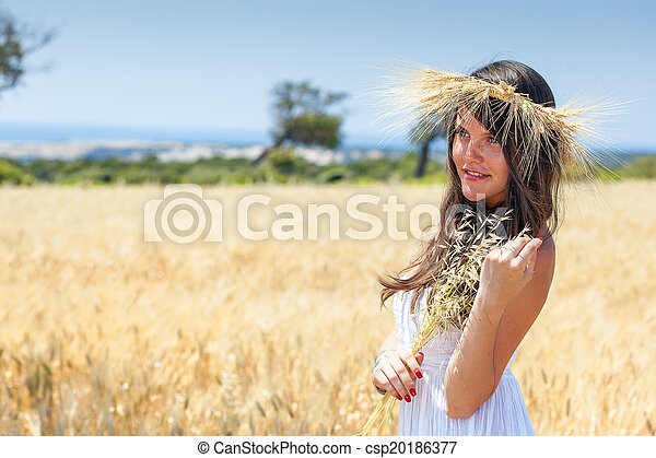 Woman is in the field with a wreath - csp20186377
