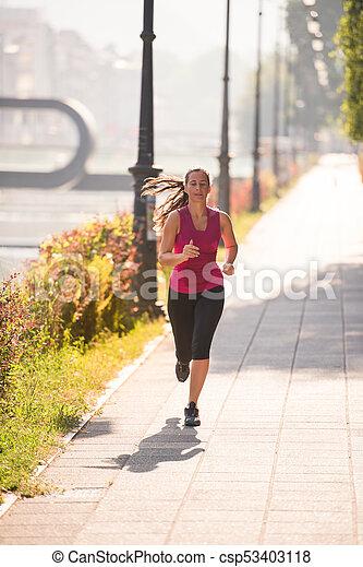 woman jogging at sunny morning - csp53403118
