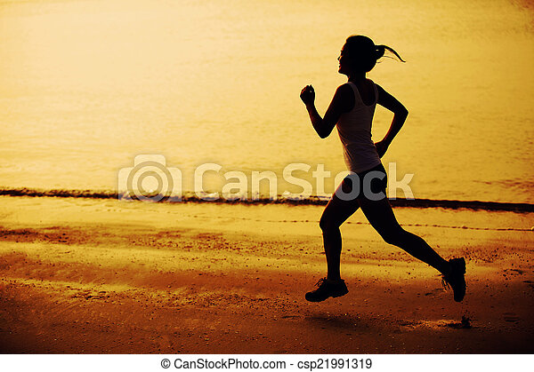 woman jogging on sunset beach - csp21991319