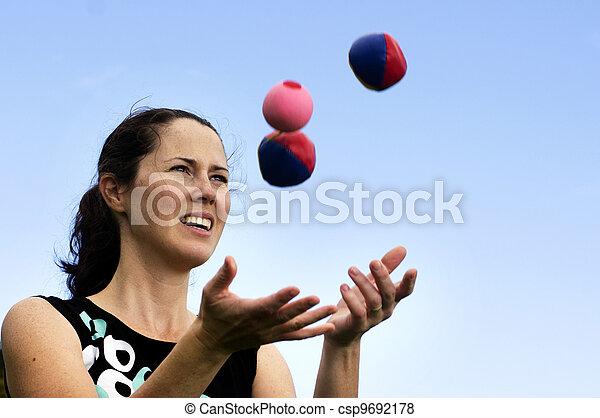 Woman Juggling Balls - csp9692178