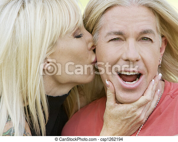 Woman kissing a man - csp1262194
