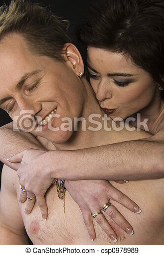 Woman kissing her husbands neck - csp0978989