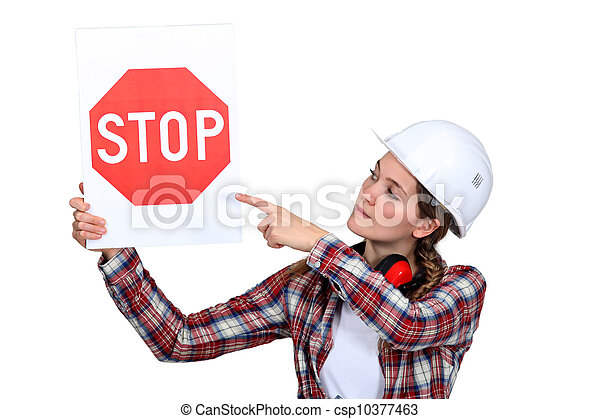 Woman laborer pointing stop sign - csp10377463