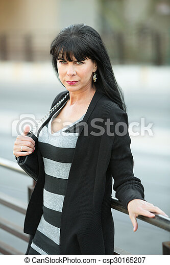 Woman Leaning Against Railing - csp30165207