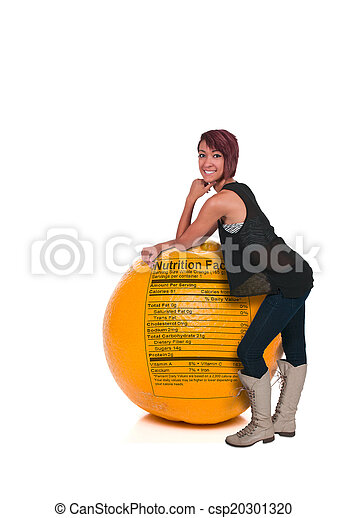 Woman Leaning on Orange with Nutrition Label - csp20301320