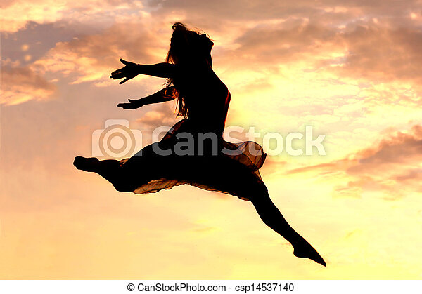 Woman Leaping at Sunset - csp14537140