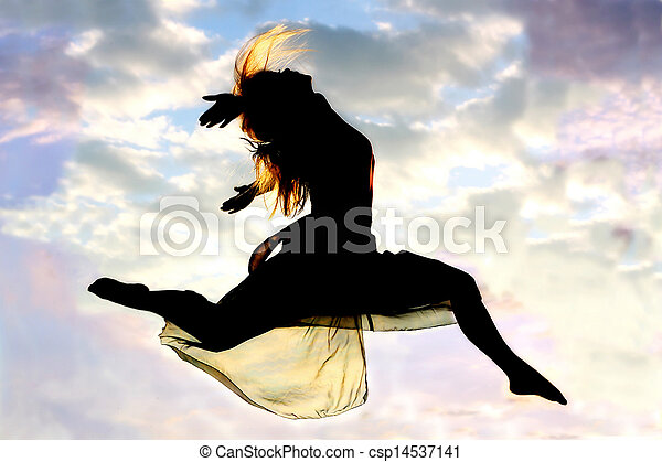 Woman Leaps through Air Silhouette - csp14537141