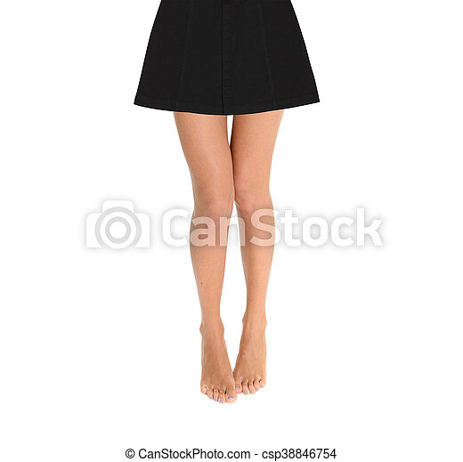 Woman legs in a skirt isolated on a white background - csp38846754