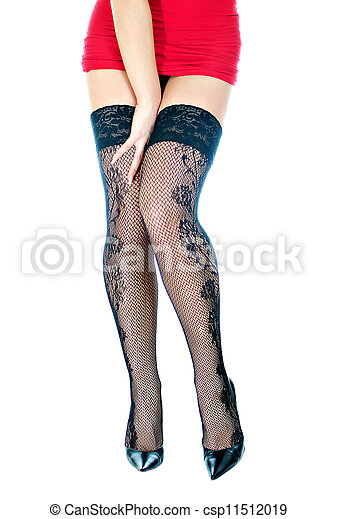 Woman legs in black stockings. Isolated on white. - csp11512019