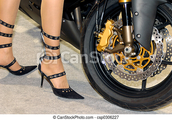 Woman legs near a bike - csp0306227