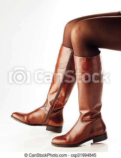 Woman Legs Wearing Brown Leather High Boots White Background