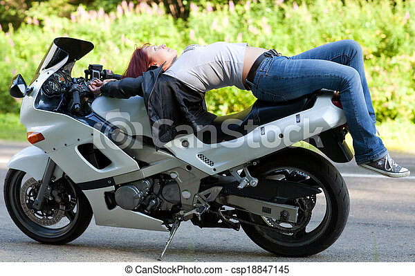 woman lies on a motorcycle - csp18847145