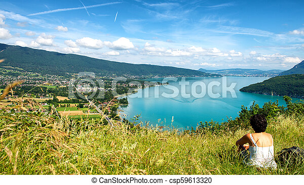 woman looking at Annecy lake in France - csp59613320