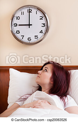 Woman looking at clock - csp20063526