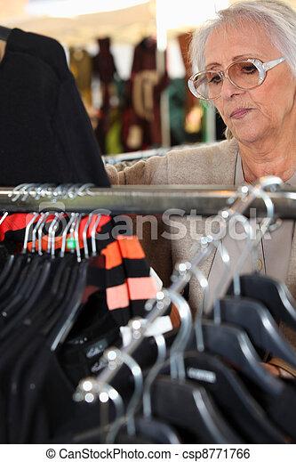 Woman looking at clothing - csp8771766