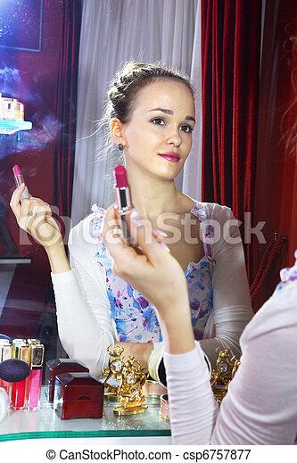 woman looking at mirror - csp6757877