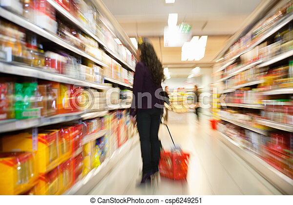 Woman looking at products in shopping store - csp6249251