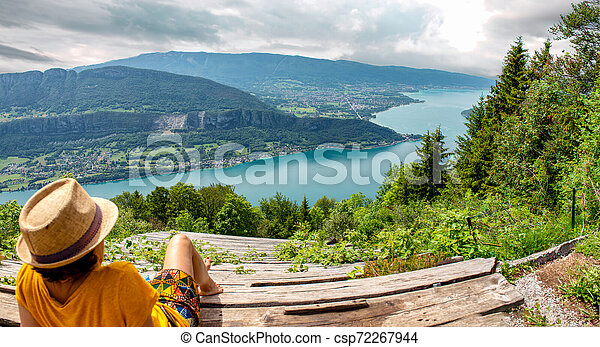 woman looking at the landscape of Lake Annecy - csp72267944