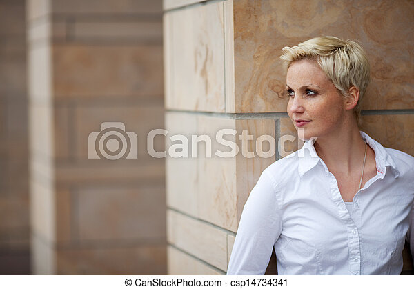 Woman Looking Away While Leaning On Pillar - csp14734341