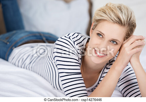 Woman Looking Away While Lying On Bed - csp14276446