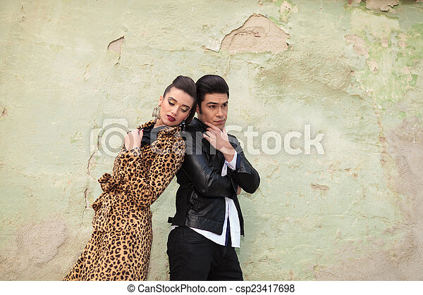 woman looking down while leaning on her lover - csp23417698