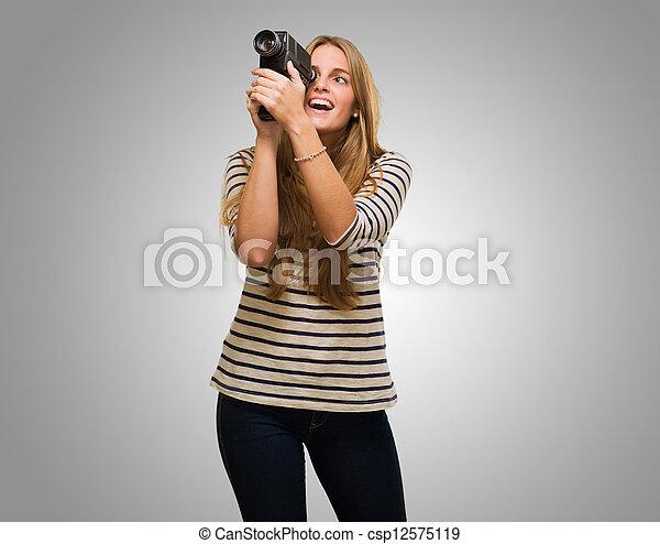 Woman Looking Through A Camera - csp12575119