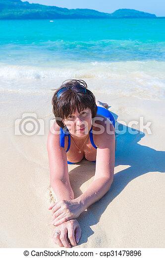 woman lying in the sea - csp31479896