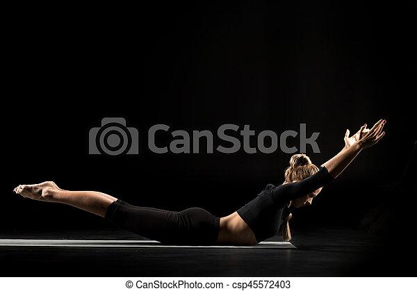 woman lying in yoga position woman performing viparita