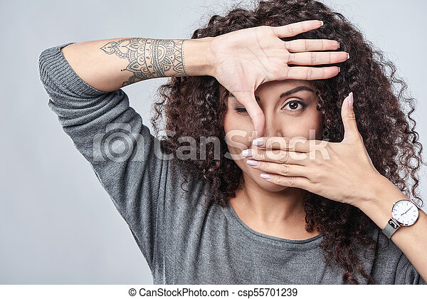 woman making frame with hands - csp55701239