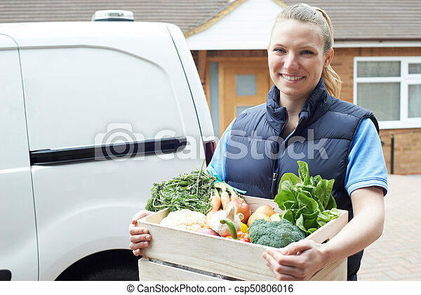 Woman Making Home Delivery Of Organic Vegetable Box - csp50806016