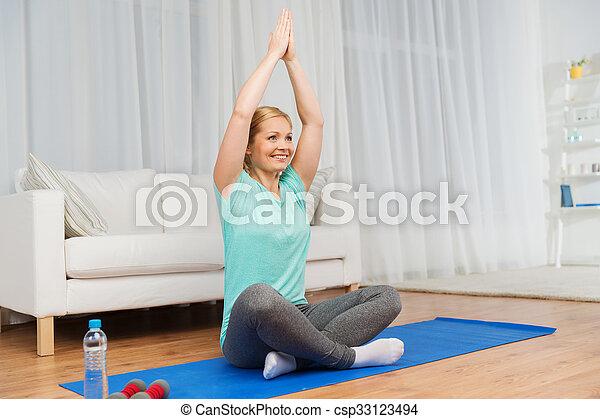woman making yoga meditation in lotus pose on mat fitness
