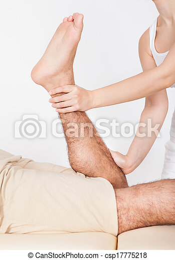 Woman Massaging Man's Foot - csp17775218