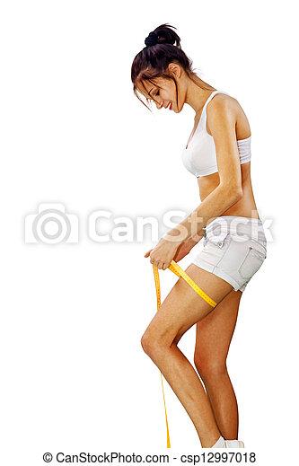 woman measures her leg l - csp12997018