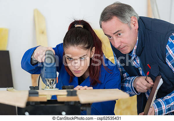 woman mechanic using an angle grinder - csp52535431