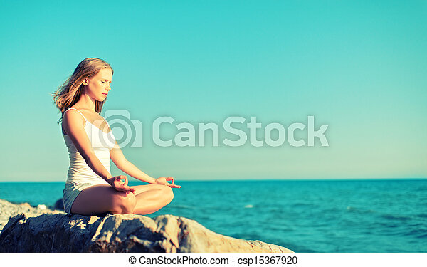 woman meditating in lotus yoga on beach woman meditating
