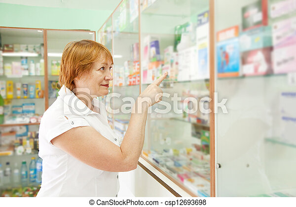 woman near counter in drugstore - csp12693698