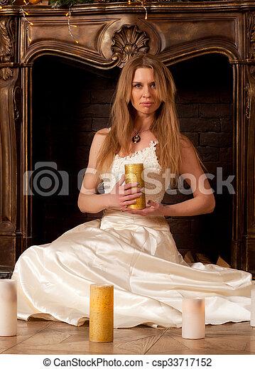 Woman near the fireplace - csp33717152